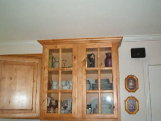 glass faced china cupboard built into kitchen cupboards